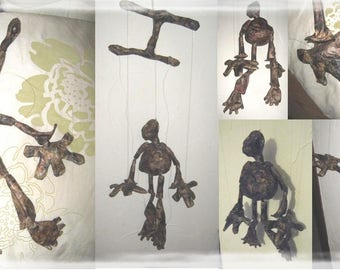 Articulated puppet. Waxed paper.