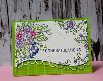 Birthday card with flowers and green background