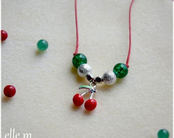 Necklace with cherry pendant and beads