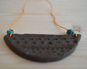 Black clay aztec necklace