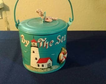 Lighthouse painting on pail
