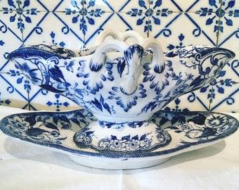 Porcelain sauce boat. Blue 'Flora' Creil and Montereau model. Nineteenth century. Rare antique french.