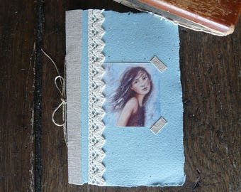 Little blue book with illustration, linen, lace