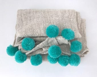 Natural with turquoise pom pom blanket