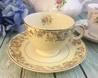 Glam Gold Scroll Trim Swing Handle Florals on Ivory Taylor Smith Taylor USA #5442 Teacup and Saucer Vintage Multiples