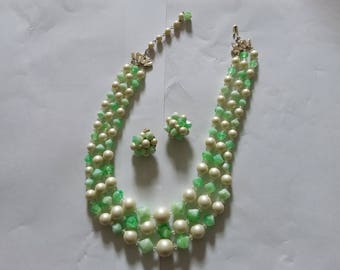 Pretty green and white multi strand beaded necklace and clip on earrings.  Estate found costume jewelry