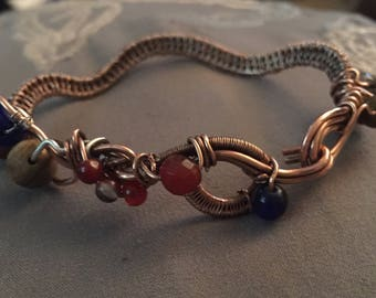 Woven wire bracelet.