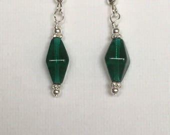 Green dangle earrings. Green drop earrings. Green glass dangle earrings with silver embellishment on silver ear wire.