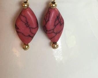 Orange dangle earrings. Orange and black dangle earrings. Orange drop earrings. Hanging on gold ear wire.