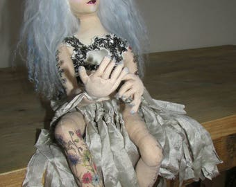 Warrior princess cloth art doll, with tattoos and white blue hair and avatar make up