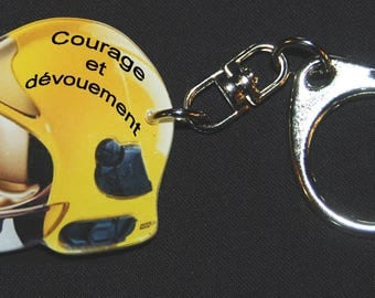 Photo of a yellow FIREMAN helmet Keychain motto Courage and dedication