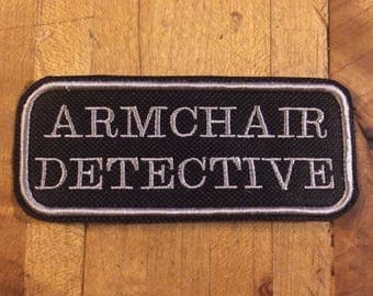 Armchair detective iron on patch