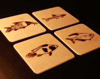 4x pyrographic wooden coasters with fish/aquaria theme
