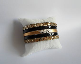 Gold and black leather cuff