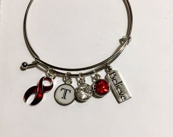 Stroke survivor charm bracelet with personalized initial