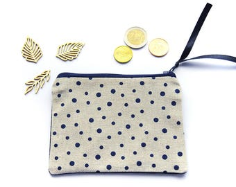 Wallet in beige fabric with dots and black back