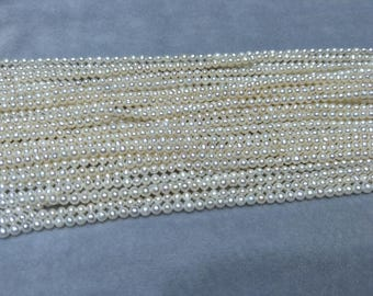 White pearl,tiny pearl strings,small,fresh water pearl,near round pearl.