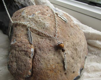 Tiger eye stone and feathers necklace