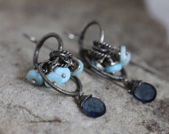 raw sterling silver earrings. multi hoops. blue topaz and blue opal gemstones. oxidized silver