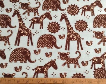 Flannel zoo animals on blue background cotton fabric by the yard