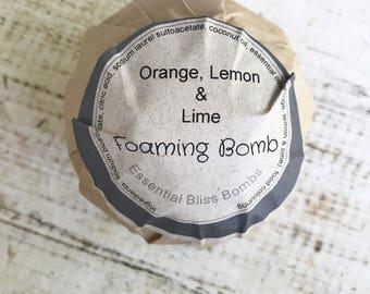 Orange lemon and lime foaming bath bomb