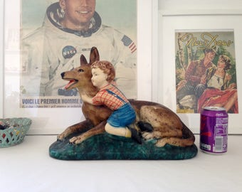 Large sculpture vintage dog and child. Year 1950