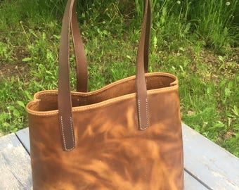Distressed leather tote.