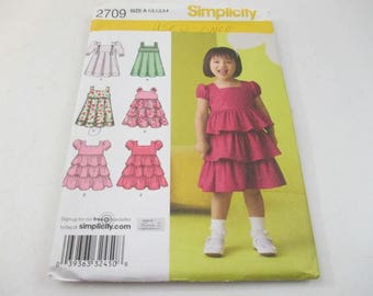 Simplicity sewing pattern for toddlers' dress with skirt variations pattern 2709, pleats and ruffles