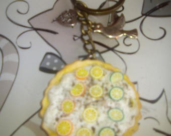 Key fob pie whipped with slices of canes orange lemon and lime green