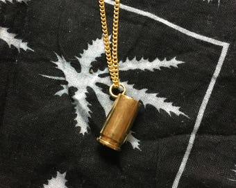 Gold plated 9mm bullet pendant.