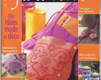 Magazine cross stitch with yarn needle thread going no. 4