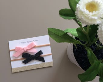 Felt bows on one size fits most nylon headband - light pink and charcoal grey