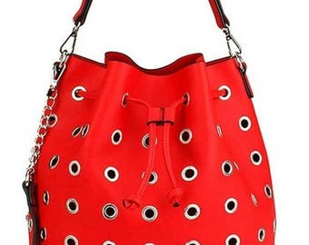 Red purse with holes