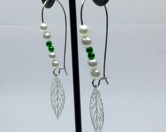 Green and pearlescent bead leaf earrings