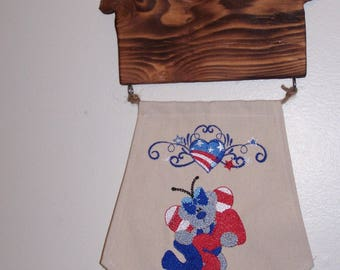 Patriotic wood and embroidered wall hanging
