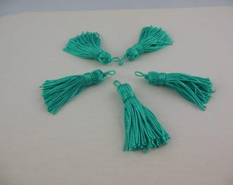 A turquoise blue color rayon thread tassel