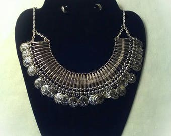 This one of a kind necklace set comes with hoop earrings