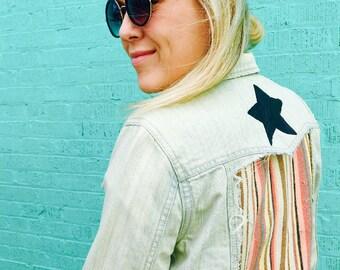 Light denim black star jacket.  Women's Size 8.