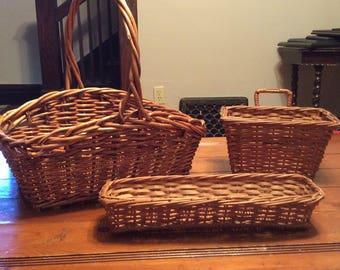 A set of 3 vintage wicker baskets