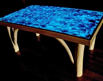 Boutique glowing coffee table, handcrafted with Ash and azure tinted resin top. Glows in the dark.