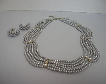 A multi-strand Vintage choker necklace with matching earrings