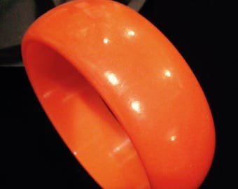 bakelite one inch wide bangle/ bracelet bright pumpkin orange from the 1930's