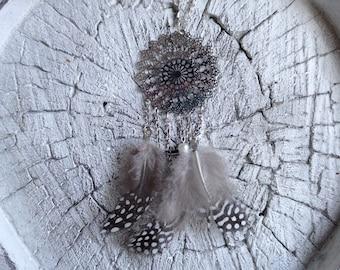 Necklace with a dreamcatcher pendant