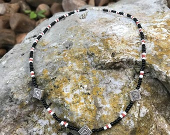 Silver Plated Spacers on a Orange, White, and Black Seedbead Necklace