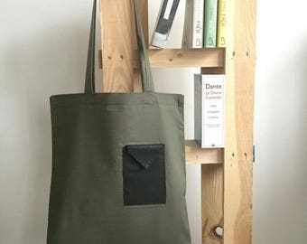 Cotton tote bag with a hand stitched leather pocket