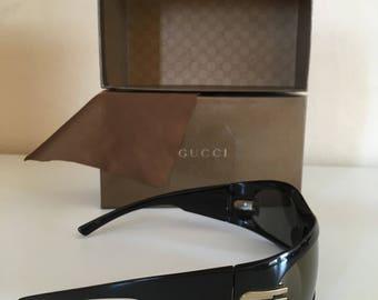 2 GUCCI Sunglasses, one still with original box!