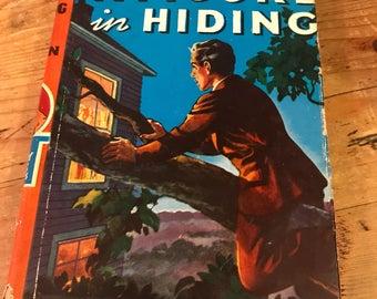 Hardy boys 1937 a figure hiding with dust jacket