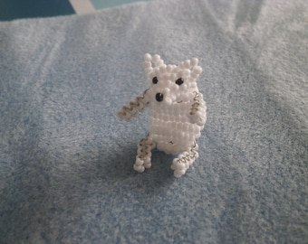 White bear with seed beads.