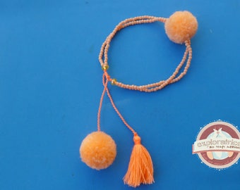 Bracelet made of glass and coral pink and orange tassel ethnic