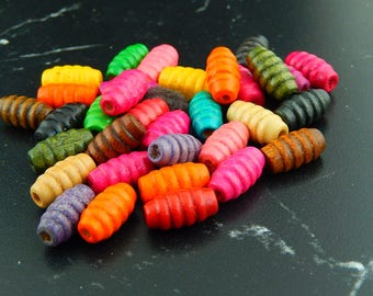 10 striated color oval wood beads
